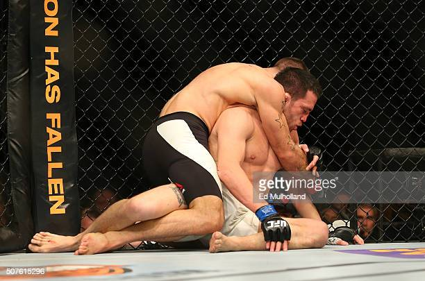 Tarec Saffiedine controls the body of Jake Ellenberger in their welterweight bout during the UFC Fight Night event at the Prudential Center on...