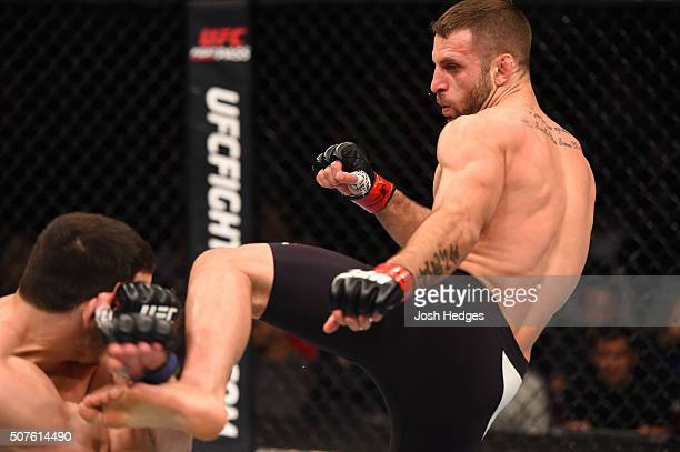 Tarec Saffiedine kicks Jake Ellenberger in their welterweight bout during the UFC Fight Night event at the Prudential Center on January 30, 2016 in...