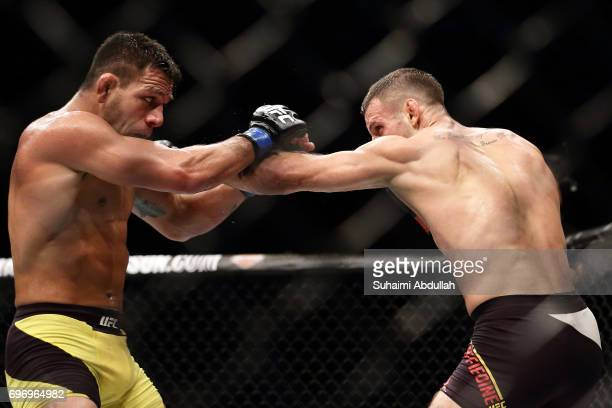 Tarec Saffiedine of Belgium fights Rafael dos Anjos of Brazil in the Welterweight Bout during UFC Singapore Fight Night at Singapore Indoor Stadium...