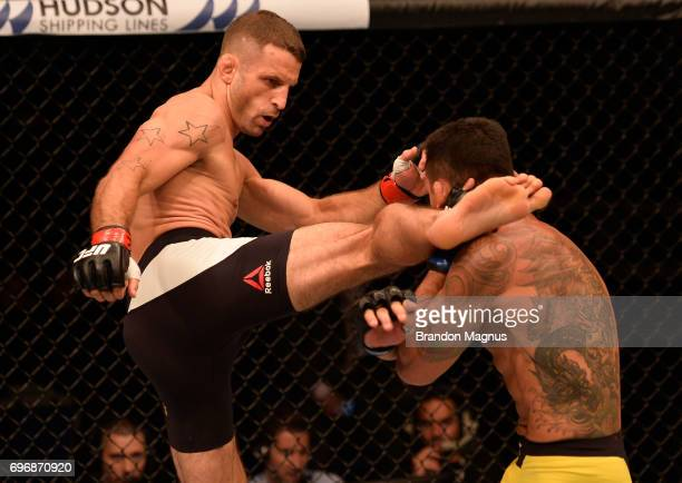 Tarec Saffiedine of Belgium kicks Rafael Dos Anjos of Brazil in their welterweight bout during the UFC Fight Night event at the Singapore Indoor...