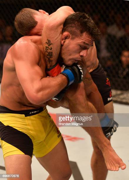 Tarec Saffiedine of Belgium knees Rafael Dos Anjos of Brazil in their welterweight bout during the UFC Fight Night event at the Singapore Indoor...