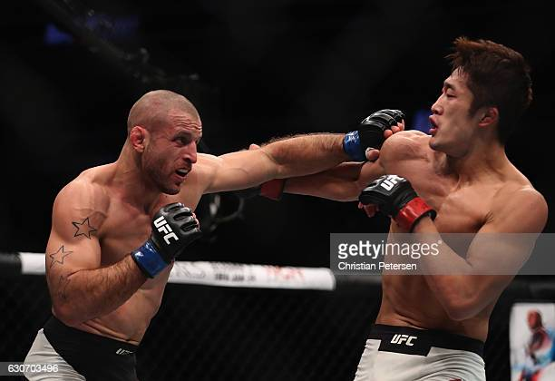 Tarec Saffiedine of Belgium punches Dong Hyun Kim of South Korea in their welterweight bout during the UFC 207 event on December 30, 2016 in Las...