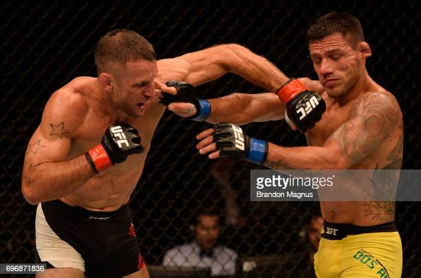 Tarec Saffiedine of Belgium punches Rafael Dos Anjos of Brazil in their welterweight bout during the UFC Fight Night event at the Singapore Indoor...
