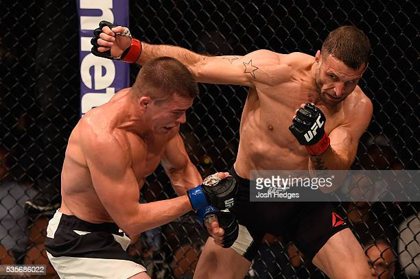 Tarec Saffiedine of Belgium punches Rick Story in their welterweight bout during the UFC Fight Night event inside the Mandalay Bay Events Center on...