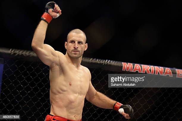 Tarec Saffiedine reacts as he enters the arena during the UFC Fight Night Singapore welterweight bout at Marina Bay Sands on January 4, 2014 in...