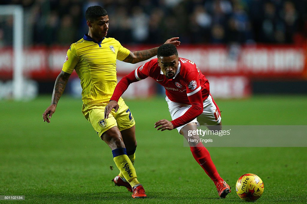 Tareiq Holmes-Dennis of Charlton (R) is tackled by Liam Bridcutt of Leeds during the Sky Bet Championship match between Charlton Athletic and Leeds United at The Valley on December 12, 2015 in London, United Kingdom.