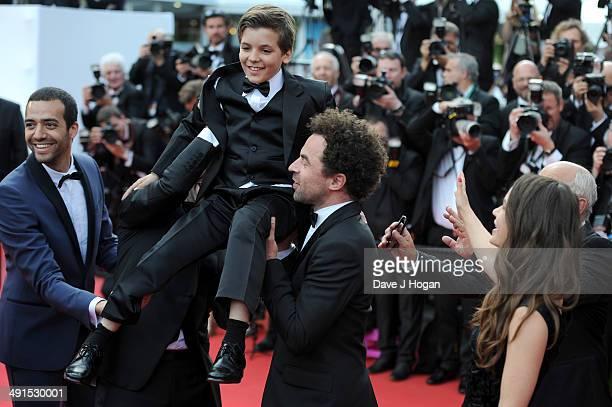 Tarek Boudali Enzo Tomasini Nicolas Benamou Alice David attend the How To Train Your Dragon 2 premiere during the 67th Annual Cannes Film Festival on...