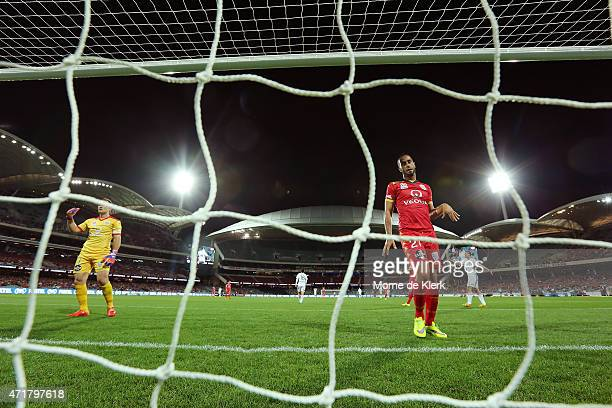 Tarek Elrich and Eugene Galekovic of Adelaide United look on after Brisbane scored a goal during the ALeague Elimination Final match between Adelaide...