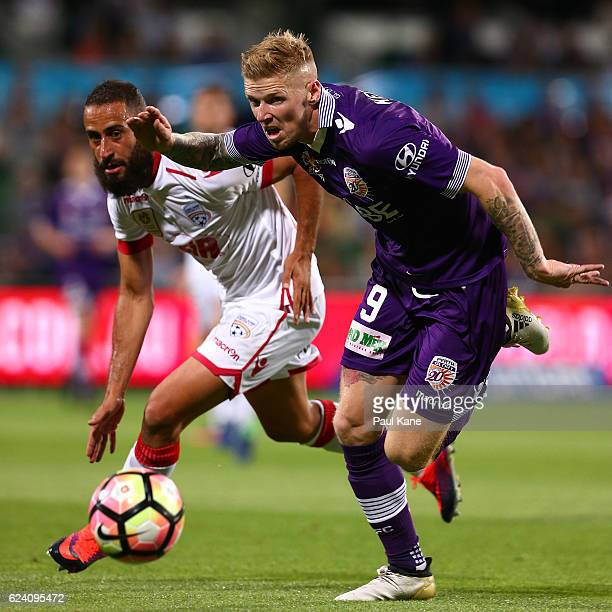 Tarek Elrich of Adelaide and Andy Keogh of the Glory contest for the ball during the round seven ALeague match between the Perth Glory and Adelaide...