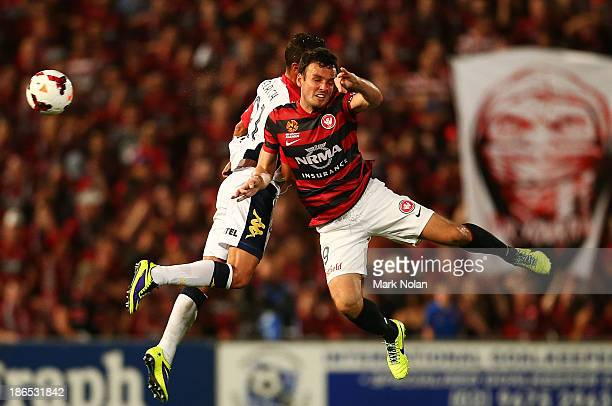Tarek Elrich of Adelaide and Mark Bridge of the Wanderers contest possession during the round four ALeague match between the Western Sydney Wanderers...