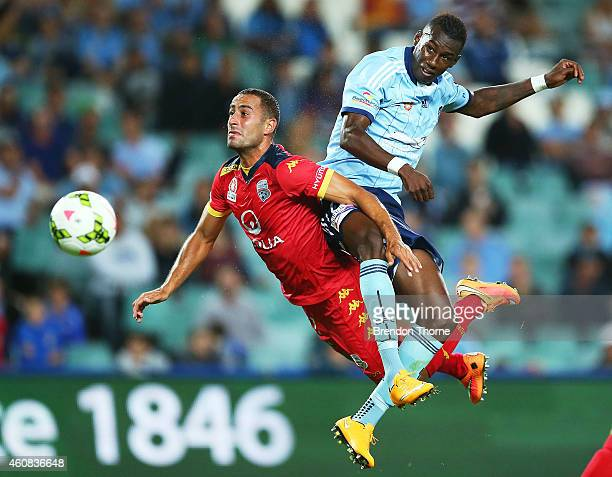 Tarek Elrich of Adelaide competes with Bernie Ibini of Sydney during the round 13 ALeague match between Sydney FC and Adelaide United at Allianz...