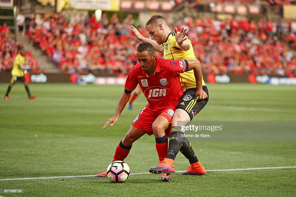 Tarek Elrich of Adelaide United and Hamish Watson of Wellington Phoenix compete for the ball during the round nine A-League match between Adelaide United and the Wellington Phoenix at Coopers Stadium on December 4, 2016 in Adelaide, Australia.