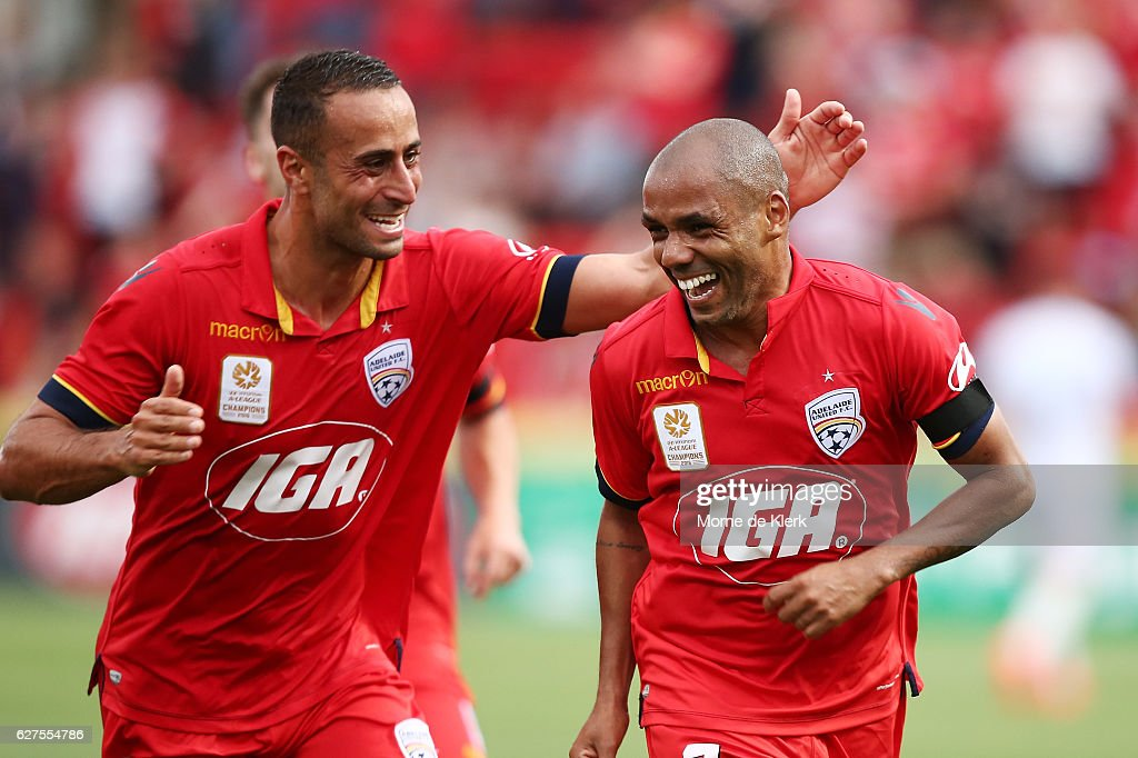 Tarek Elrich of Adelaide United congratulates teammate Henrique after he scored a goal during the round nine A-League match between Adelaide United and the Wellington Phoenix at Coopers Stadium on December 4, 2016 in Adelaide, Australia.