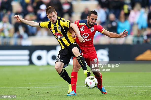 Tarek Elrich of Adelaide United is challenged by Michael McGlinchey of the Phoenix during the round 20 ALeague match between the Wellington Phoenix...