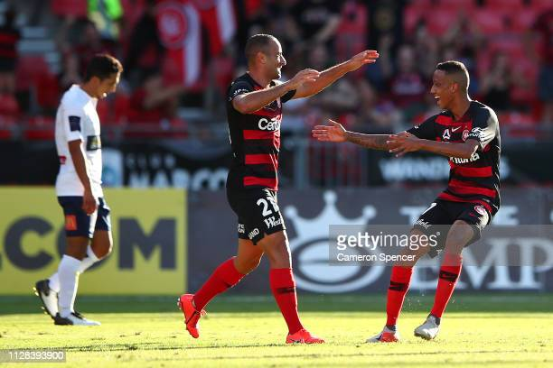 Tarek Elrich of the Wanderers celebrates scoring a goal with team mates during the round 18 ALeague match between the Western Sydney Wanderers and...