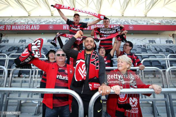 Tarek Elrich of the Wanderers poses with Western Wanderers fans behind new safe standing rails in a spectator bay during a Western Wanderers media...