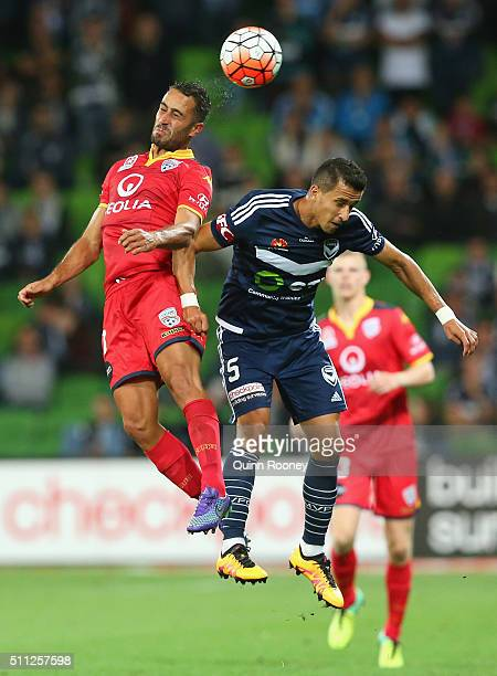 Tarek Elrich of United and Daniel Georgievski of the Victory compete to head the ball during the round 20 ALeague match between Melbourne Victory and...