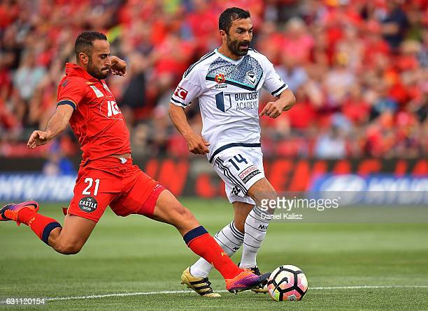 Tarek Elrich of United tackles Fahid Ben Khalfallah of the Victory during the round 14 ALeague match between Adelaide United and Melbourne Victory at...