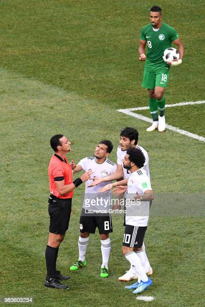 Tarek Hamed Ali Gabr and Mohamed Salah of Egypt confront Referee Wilmar Roldan as he checks with VAR concerning a penalty for Saudi Arabia during the...