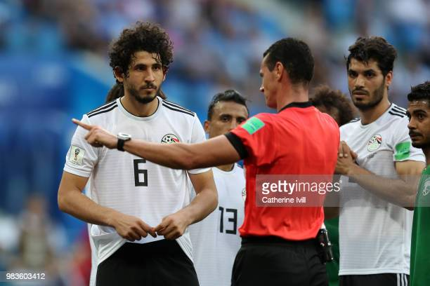 Tarek Hamed and Ali Gabr of Egypt confront Referee Wilmar Roldan as he checks with VAR concerning a penalty for Saudi Arabia during the 2018 FIFA...