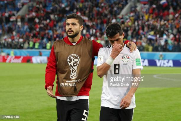 Tarek Hamed and Sam Morsy of Egypt look dejected after the 2018 FIFA World Cup Russia group A match between Russia and Egypt at Saint Petersburg...