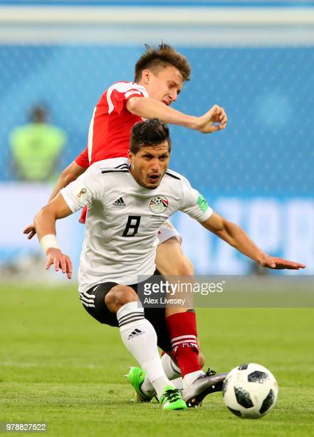 Tarek Hamed of Egypt and Ilya Kutepov of Russia in action during the 2018 FIFA World Cup Russia group A match between Russia and Egypt at Saint...
