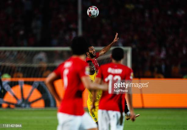 Tarek Hamed of Egypt and Marshal Nyasha Munetsi of Zimbabwe challenging for the ball during the African Cup of Nations match between Egypt and...