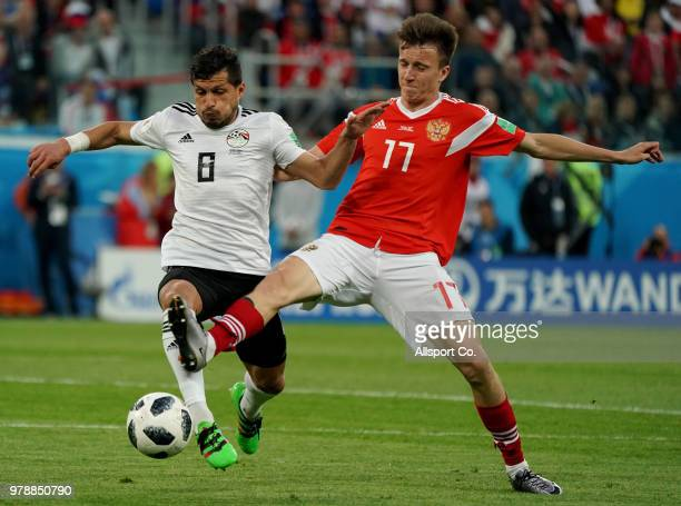 Tarek Hamed of Egypt battles Roman Zobinin of Russia during the 2018 FIFA World Cup Russia group A match between Russia and Egypt at Saint Petersburg...