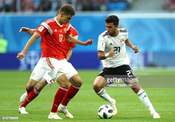 Tarek Hamed of Egypt challenge for the ball with Roman Zobnin of Russia during the 2018 FIFA World Cup Russia group A match between Russia and Egypt...