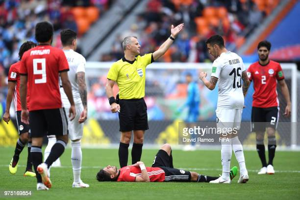 Tarek Hamed of Egypt goes down injured during the 2018 FIFA World Cup Russia group A match between Egypt and Uruguay at Ekaterinburg Arena on June 15...