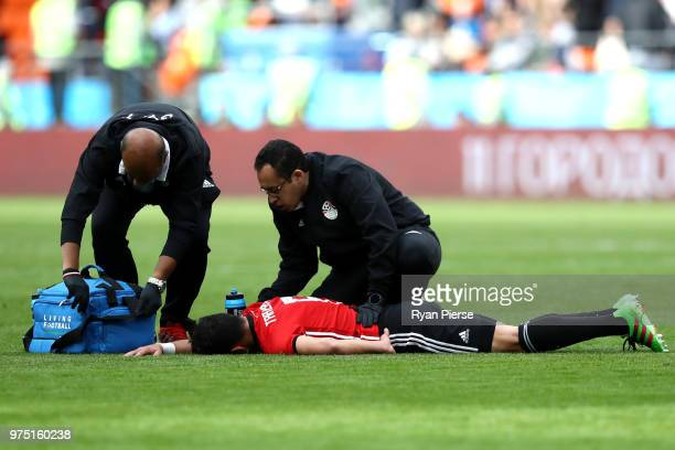 Tarek Hamed of Egypt receives treatment during the 2018 FIFA World Cup Russia group A match between Egypt and Uruguay at Ekaterinburg Arena on June...