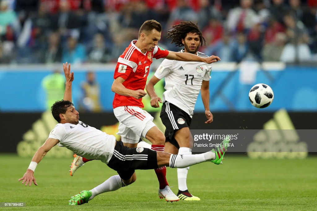 Tarek Hamed of Egypt tackles Denis Cheryshev of Russia during the 2018 FIFA World Cup Russia group A match between Russia and Egypt at Saint Petersburg Stadium on June 19, 2018 in Saint Petersburg, Russia.
