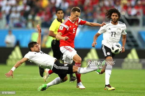 Tarek Hamed of Egypt tackles Denis Cheryshev of Russia during the 2018 FIFA World Cup Russia group A match between Russia and Egypt at Saint...