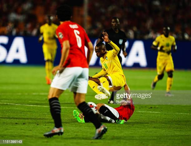Tarek Hamed of Egypt tackling Khama Billiat of Zimbabwe during the African Cup of Nations match between Egypt and Zimbabwe at the Cairo International...