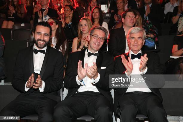Tarek Mueller Alexander Birken CEO Otto Group and Dr Michael Otto CEO Otto Group during the 2nd ABOUT YOU Awards 2018 at Bavaria Studios on May 3...