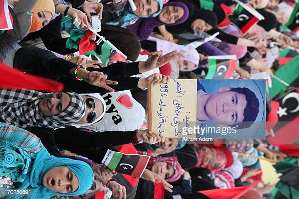 Tarek Mustafa Elashar, Killed in Abu Slim prison massacre written on small banner during women demonstration in Tripoli. 2/9/2011 Libya
