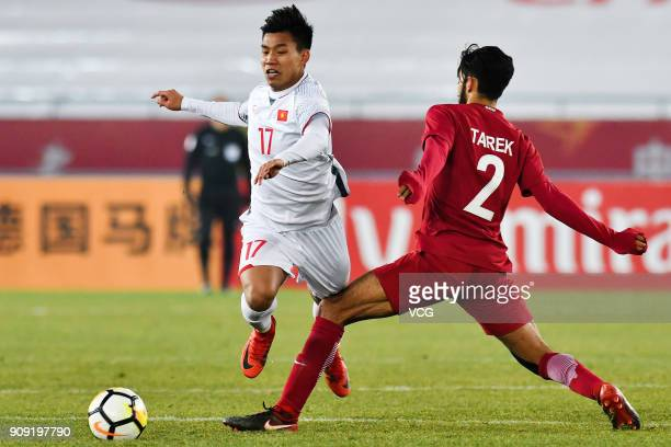 Tarek Salman 3of Qatar and Vu Van Thanh of Vietnam compete for the ball during the AFC U23 Championship semifinal match between Qatar and Vietnam at...