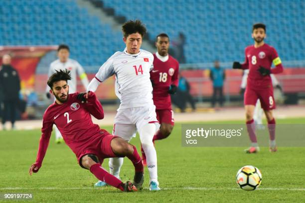 Tarek Salman of Qatar and Phan Van Duc of Vietnam compete for the ball during the AFC U23 Championship semifinal match between Qatar and Vietnam at...