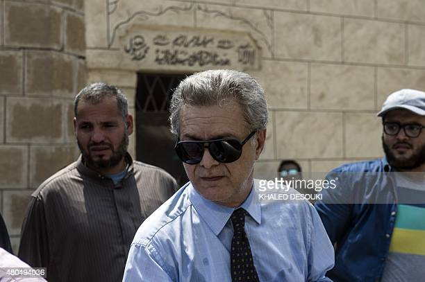 Tarek Sharif son of Cinema legend Omar Sharif attends his father's funeral at El Sayeda Nafisa cemetery in the capital Cairo on July 12 2015 Sharif...