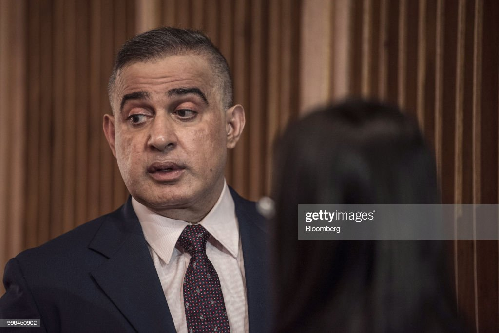 Tarek William Saab, Venezuela's chief prosecutor, speaks to a member of his staff following a news conference in Caracas, Venezuela, on Wednesday, July 11, 2018. Saab announced that shipments made through MRW parcel company, allegedly containing illegal substances, had been seized. The government has raided several MRW offices in relation to the investigation. Photographer: Carlos Becerra/Bloomberg via Getty Images