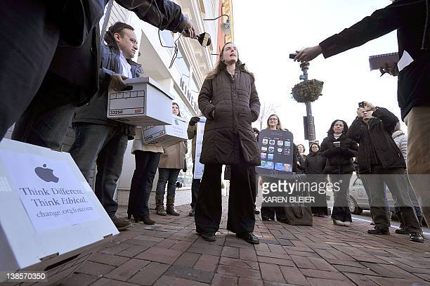 Taren StinebricknerKauffman executive director of SumOfUs speaks to reporters during a protest in front of the Apple store in Washington DC on...