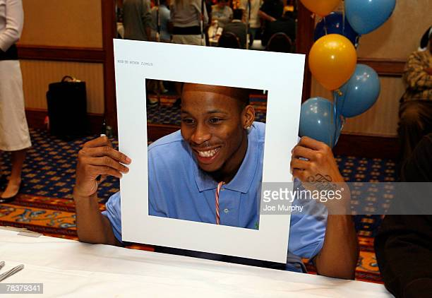 Tarence Kinsey of the Memphis Grizzlies poses with a fan's picture frame during the Memphis Grizzlies annual Holiday Toy Drive on December 10 2007 at...