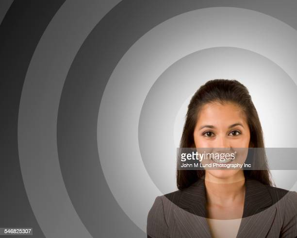 Target around face of mixed race businesswoman