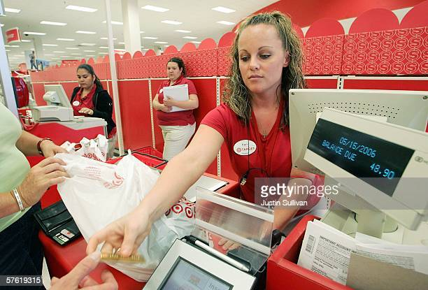 Target cashier rings up customers at a Target store May 15 2006 in Albany California Target announced a 12 percent rise in profit in its quarterly...