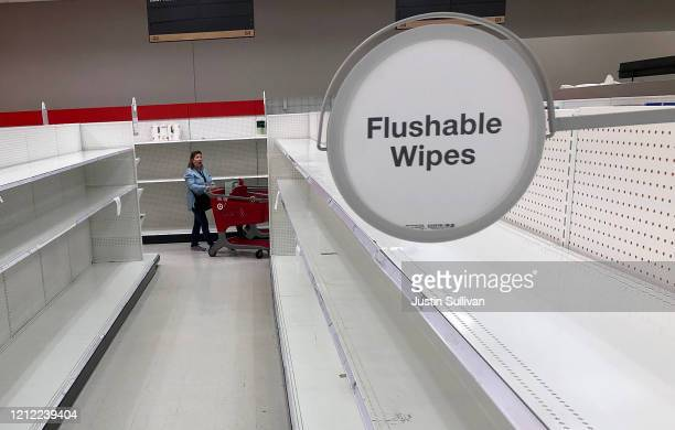Target customer reacts to empty toilet paper and paper towel shelves at a Target store on March 13 2020 in San Rafael California Some Americans are...