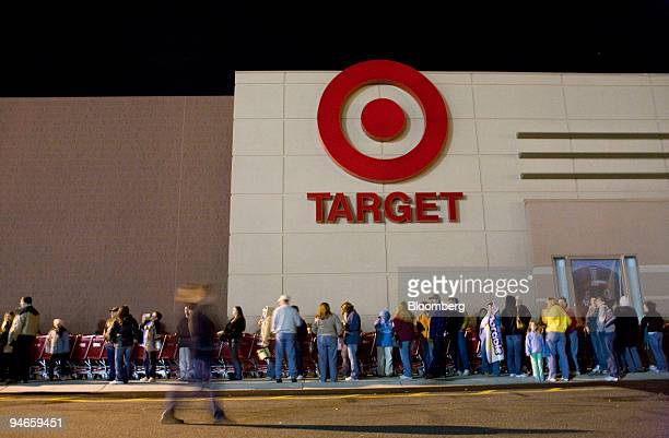 Target customers wait in a line that stretched around the building to take advantage of Black Friday sales early Friday morning November 24 2006 at...