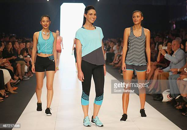 Target designer Giaan Rooney models designs from her new range Giaan by Spalding on the runway at the Target show during Melbourne Fashion Festival...