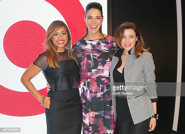 Target designers Dannii Minogue and Giaan Rooney pose with Australian singer Jessica Mauboy on the runway at the Target show during Melbourne Fashion...