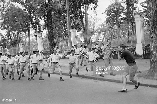 Target Newsmen Saigon South Vietnam Swinging their truncheons Saigon's riot policemen bear down on a news photographer who had been assigned to take...