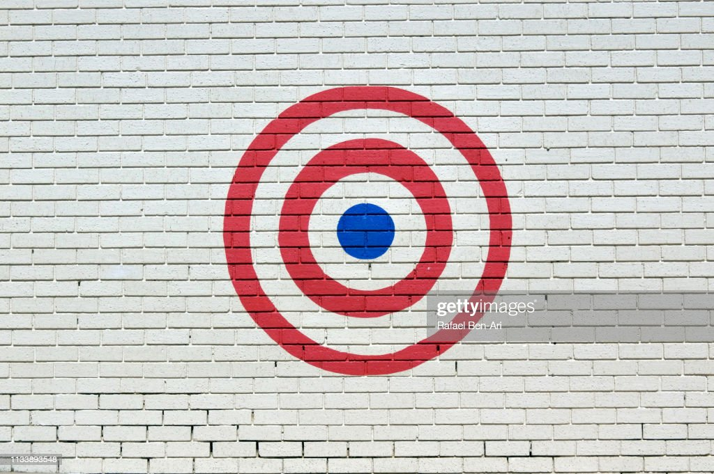 Target sign on a brick wall : Stock Photo